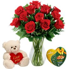 Send 12 Red Roses In Vase With Vochelle Hazelnuts Chocolate & Small Bear to Pampanga